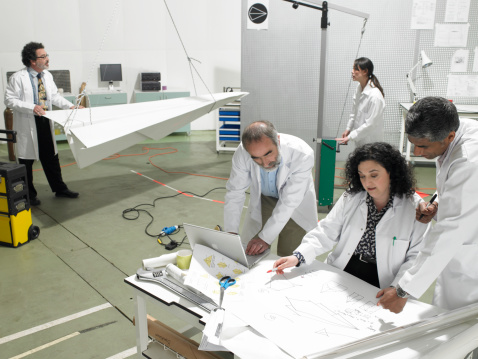 Scientist discussing plans in laboratory